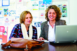 NPC academic adviser Lisa Jayne helps student Kayla Downs.