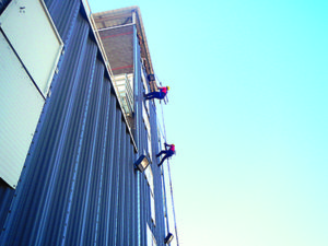 Students learn to repel down the 60-foot tower.